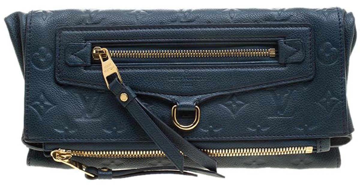 8abd95c1d907 Louis Vuitton Orage Monogram Empreinte Leather Petillante Clutch in Blue -  Lyst