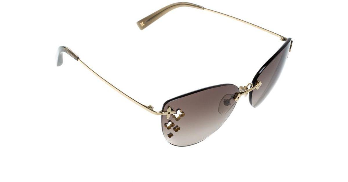 ebf160ea152 Lyst - Louis Vuitton Gradient Z0051u Desmayo Rimless Cat Eye Women  Sunglasses in Brown
