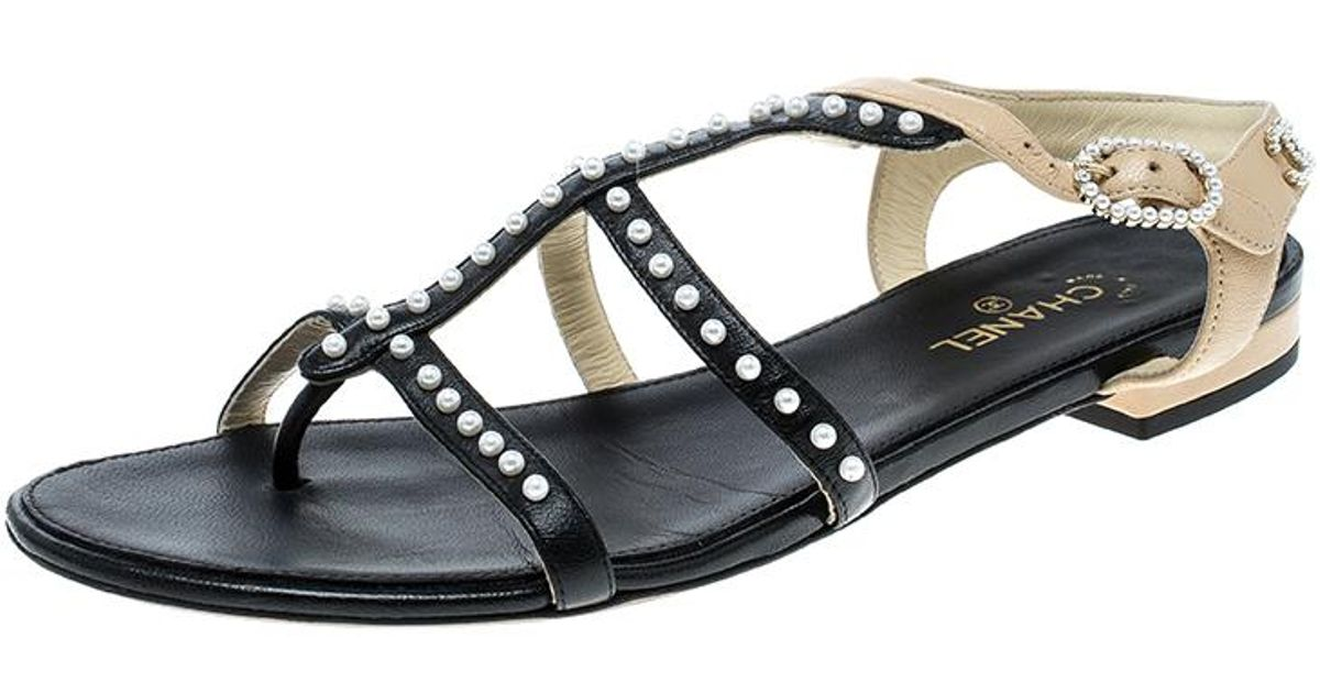 a45c3bd9f Lyst - Chanel  beige Leather Faux Pearl Embellished Strappy Flat Sandals in  Black