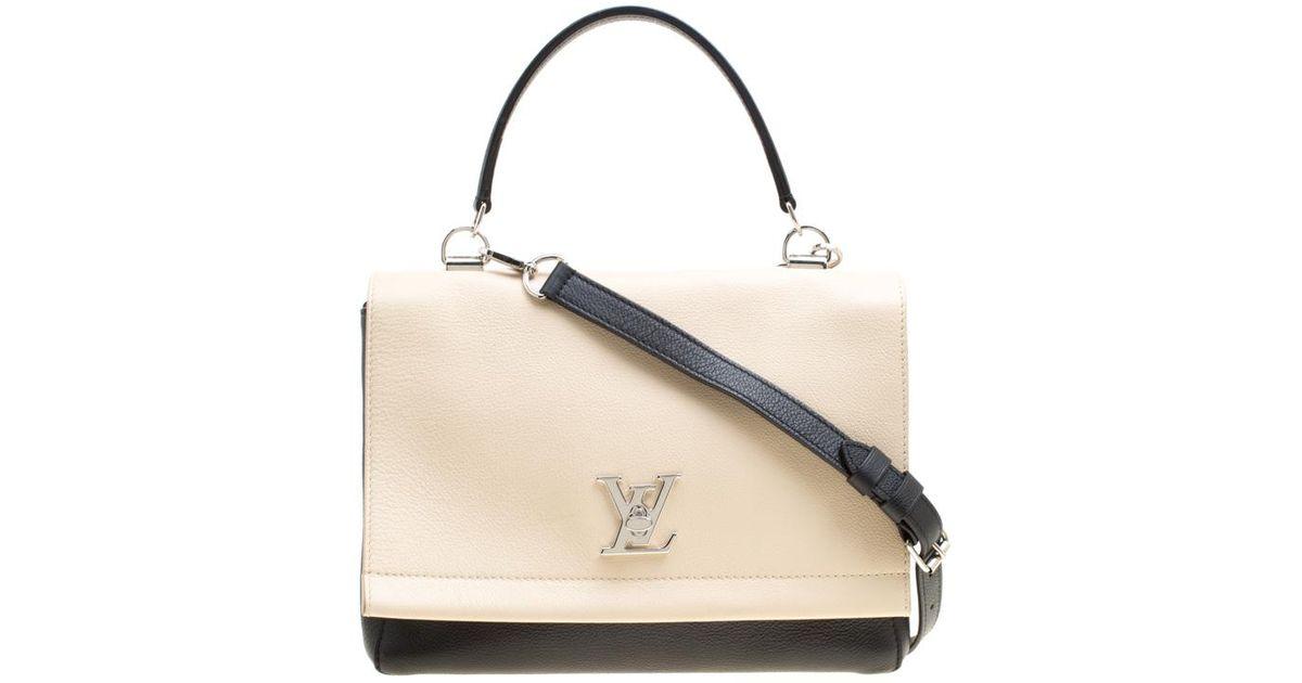 c627ed43db06 Lyst - Louis Vuitton  beige Leather Lockme Ii Bag in Black
