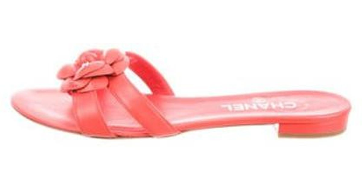 5d94a6d5dfc6 Lyst - Chanel Camellia Slide Sandals Coral in Metallic