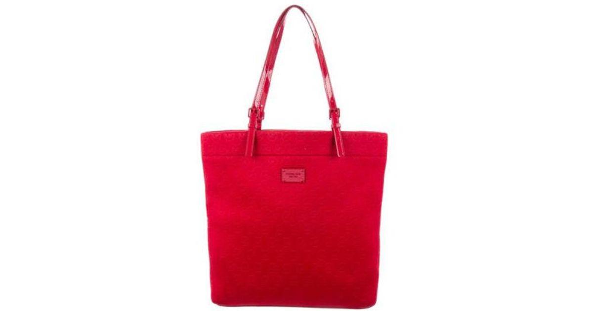 302889eb0e7c Lyst - Michael Michael Kors Michael Kors Monogram Neoprene Bag Red in  Natural
