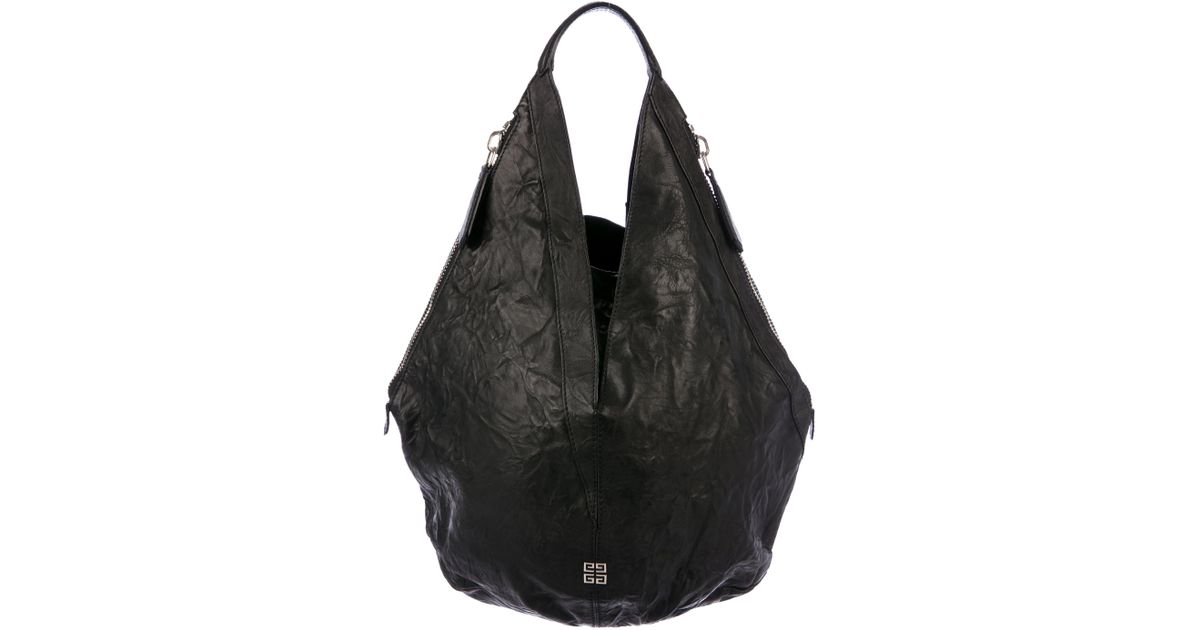 c0c2660dee Lyst - Givenchy Tinhan Leather Hobo Black in Metallic