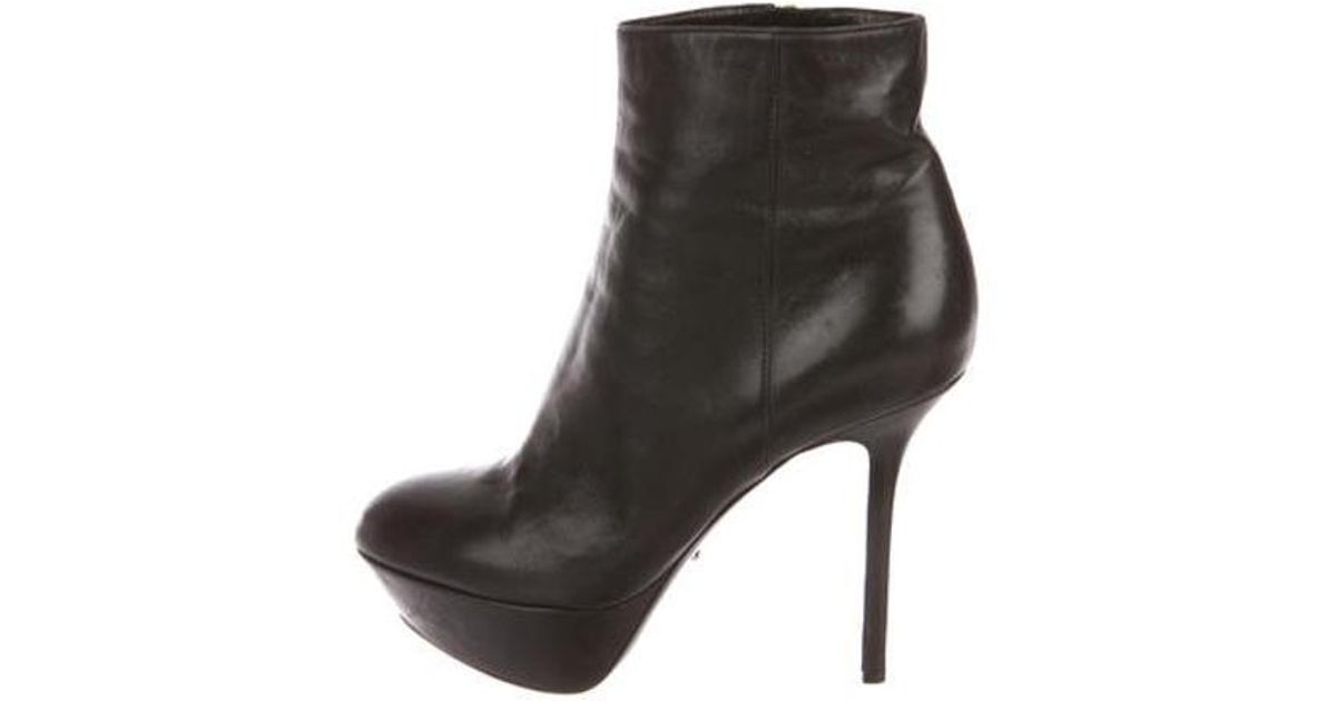 e418143d6e3 Lyst - Sergio Rossi Leather Platform Booties in Black