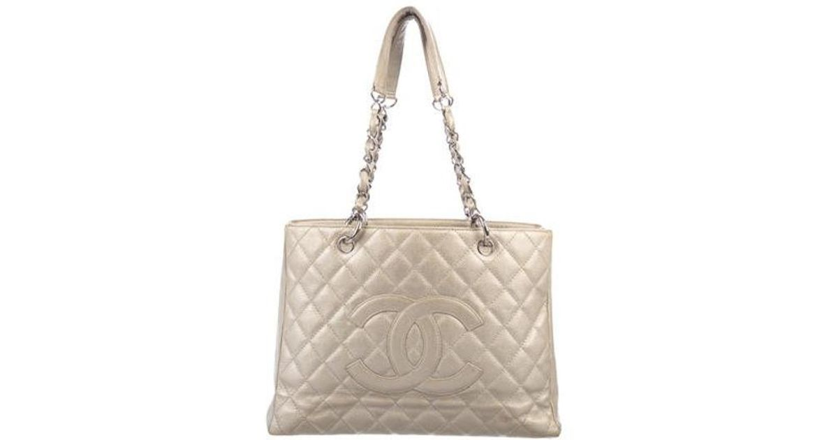 1981a363406a40 Lyst - Chanel Caviar Grand Shopping Tote in Metallic