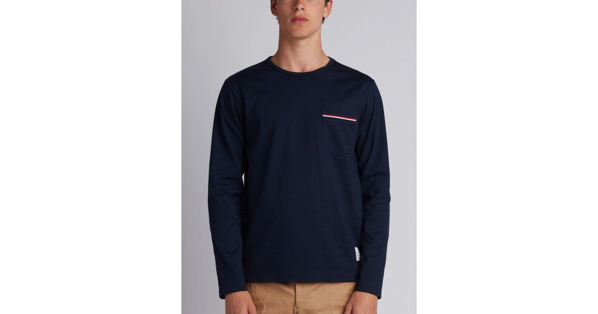 47b6a3bca3f thom-browne-blue-Long-Sleeve-T-shirt-With-Chest-Pocket-In-Navy-Jersey.jpeg