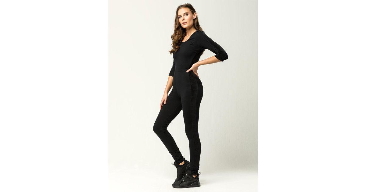 bd4cbd6222a ... V-neck Velour T7 Jumpsuit  Lyst - Puma T7 Velour Womens Jumpsuit in  Black ...