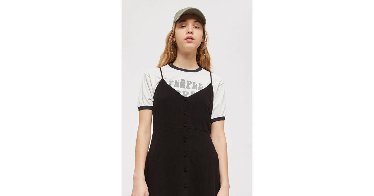 fc7ccef3a Lyst - TOPSHOP Petite Button Asymmetric Hem Mini Dress in Black