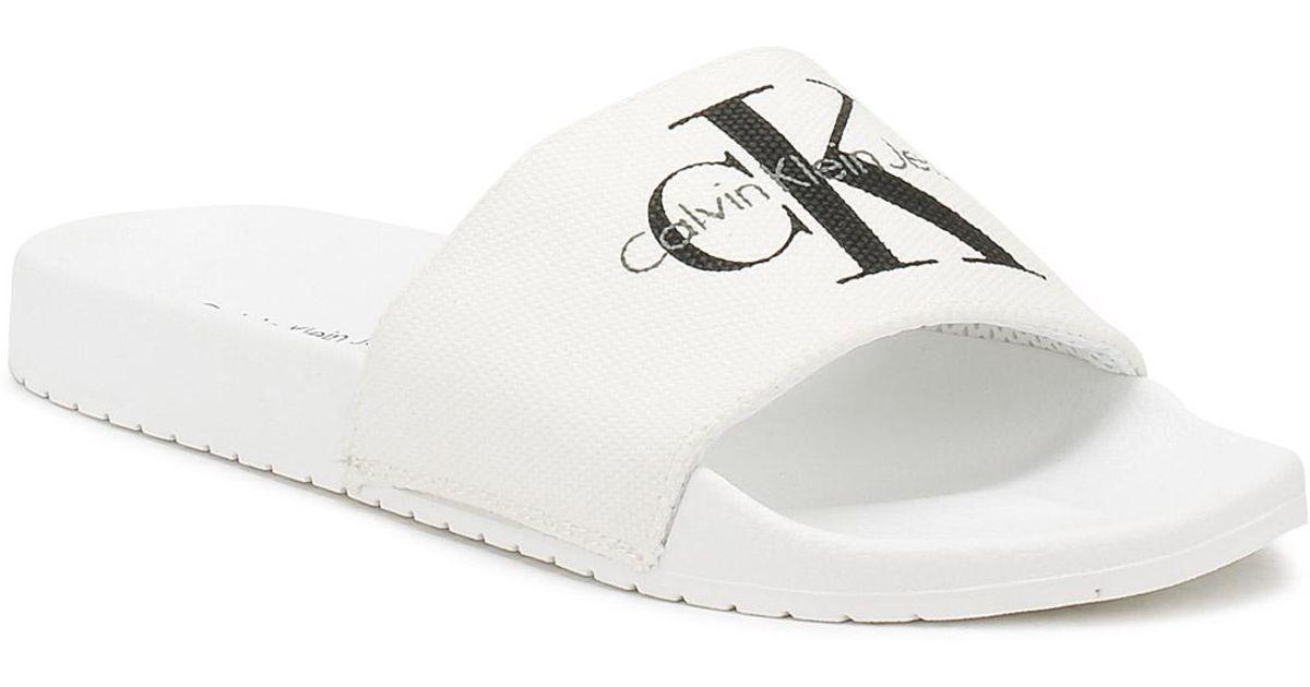 dda6f0d5df8 Calvin Klein Mens White Viggo Slides in White for Men - Lyst