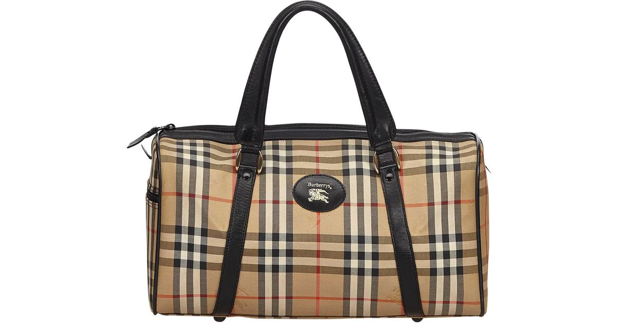 4dd7b565b743 Lyst - Burberry Pre-owned Cloth Travel Bag in Brown
