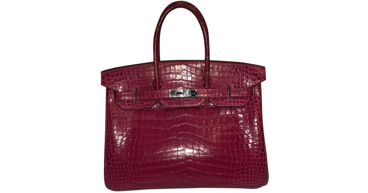 b6e9f39f817e9 Hermès Birkin 35 Crocodile Handbag in Pink - Lyst