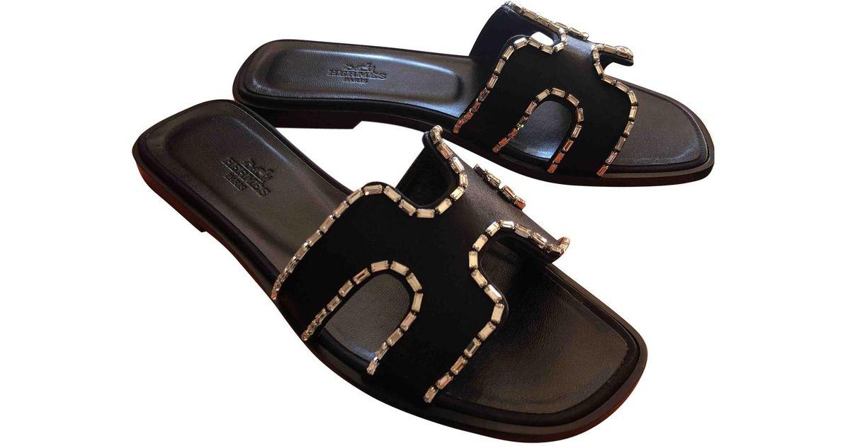en stock belle qualité style de la mode de 2019 Mules Oran en cuir Hermès en coloris Black