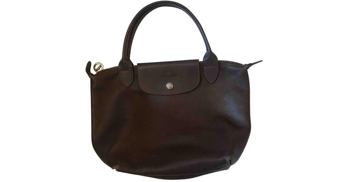 48db6c5565dd Longchamp Pliage Brown Leather Handbag in Brown - Lyst