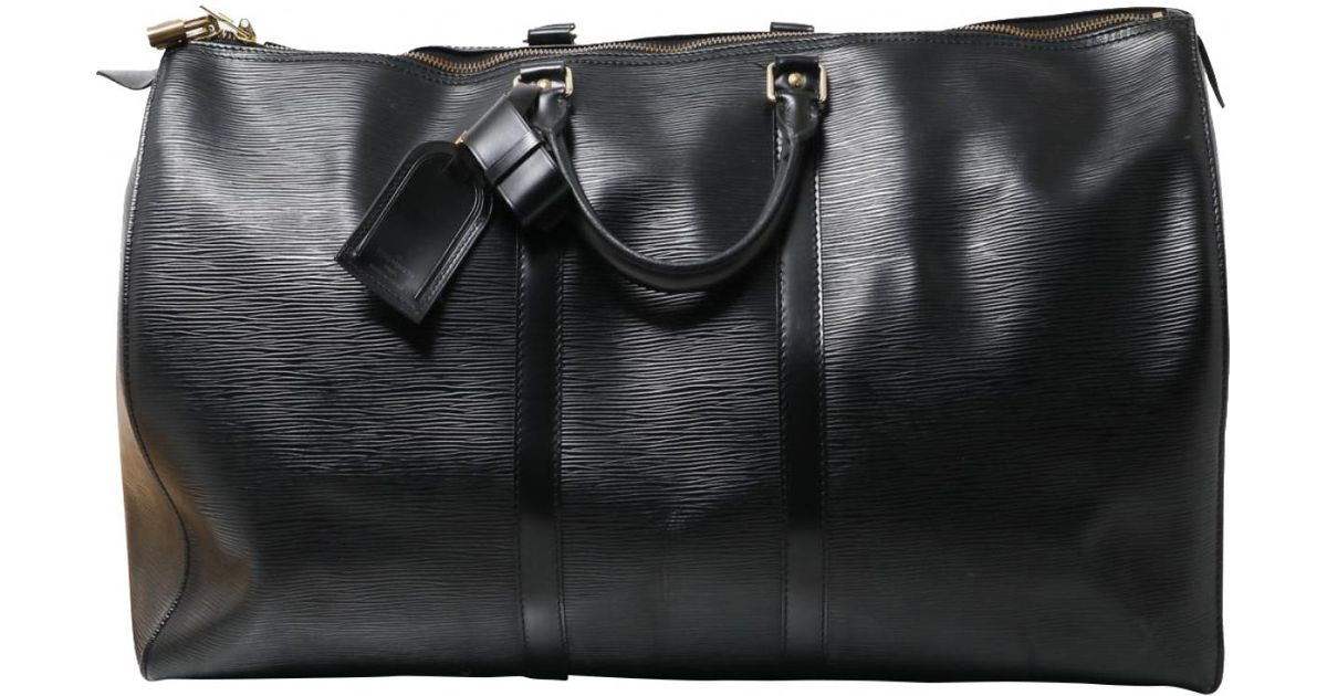 7e6b100ab7bb Lyst - Louis Vuitton Keepall Leather Weekend Bag in Black