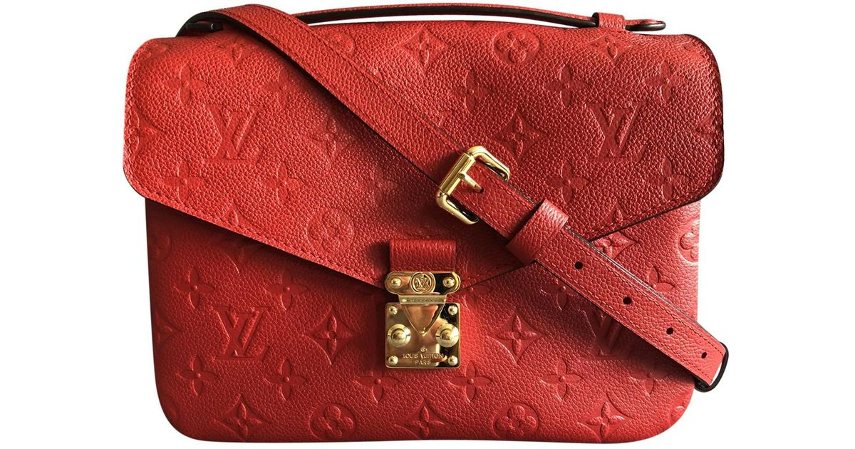 25b1e7654bd5 Lyst - Louis Vuitton Metis Leather Crossbody Bag in Red