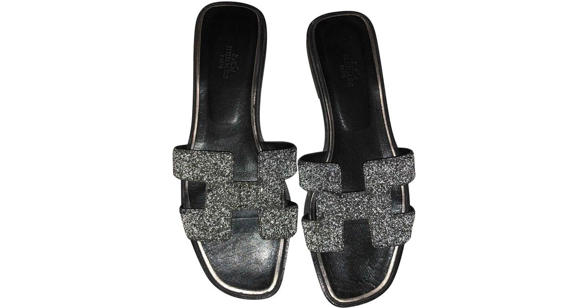 3cb80ef64a6b Lyst hermès pre owned oran glitter flip flops in gray jpg 1200x630 Hermes  flip flops