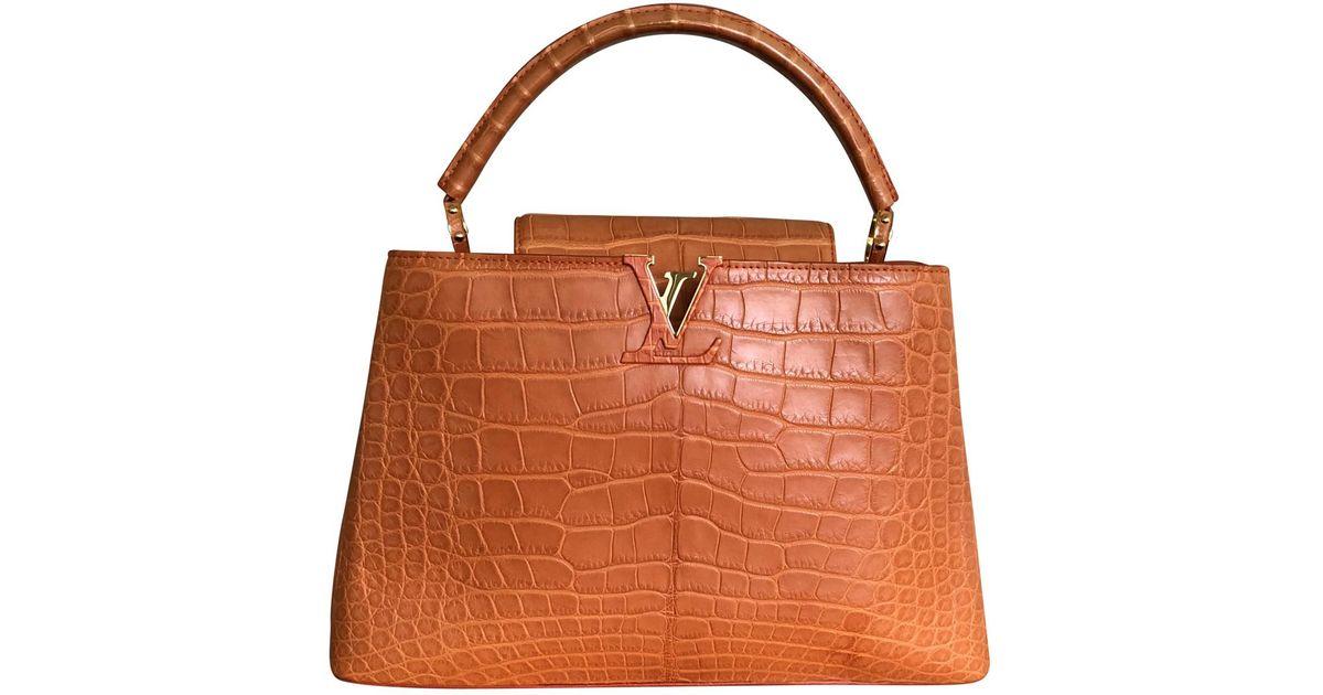 20150f9e2479 Louis vuitton capucine crocodile handbag in orange lyst jpeg 1200x630 Louis  vuitton crocodile bag