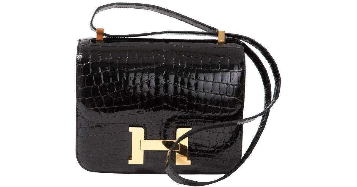 764b33e5e1 Sac bandoulière Constance en crocodile Hermès en coloris Noir - Lyst