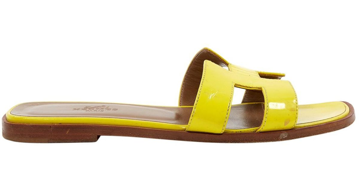 bea48cf5ab4e Hermès Oran Yellow Patent Leather Sandals in Yellow - Lyst