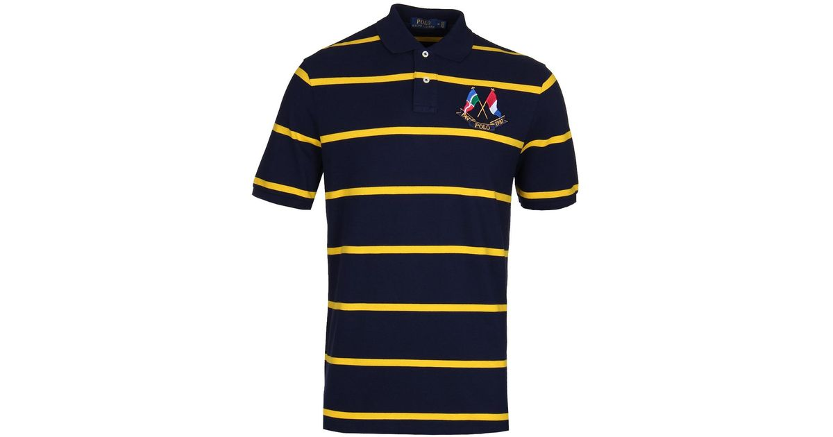 a52713762 Polo Ralph Lauren Navy   Yellow Stripe Cross Flags Polo Shirt in Blue for  Men - Lyst