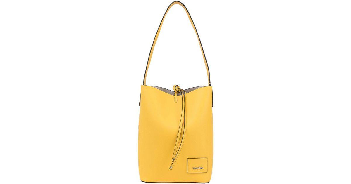 e69c02d83af Calvin Klein Shoulder Bag in Yellow - Lyst