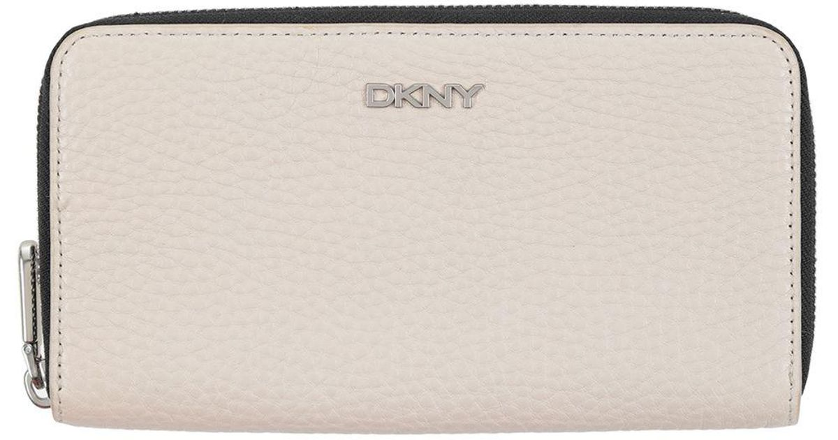 cf0eb7d00142e4 Lyst - Dkny Wallet in Natural