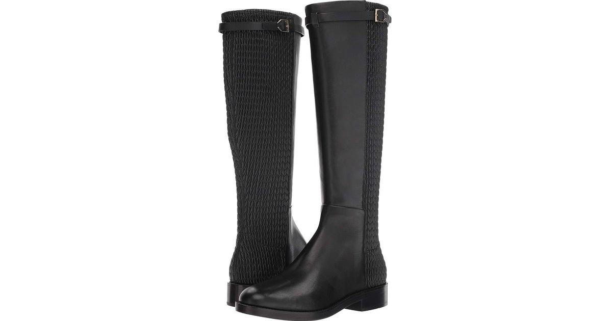 4f7cdfdb666 Lyst - Cole Haan Lexi Grand Stretch Strap Boot in Black - Save 29%