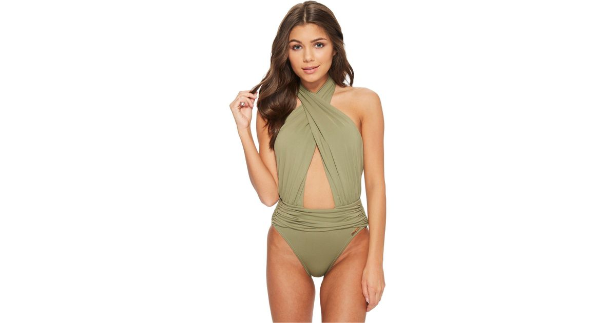 13a1f178c52ac Vince Camuto Riviera Solids Wrap Halter Neck One-piece Swimsuit in Green -  Lyst