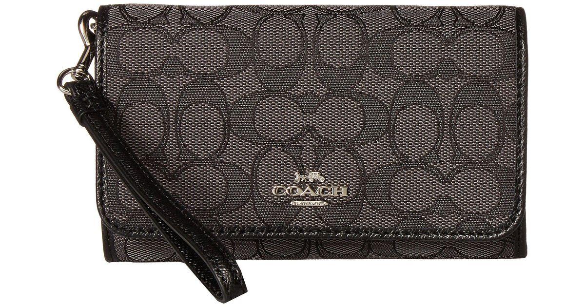 1047d89a63 Lyst - COACH Signature Phone Clutch (sv black Smoke black) Clutch Handbags  in Black