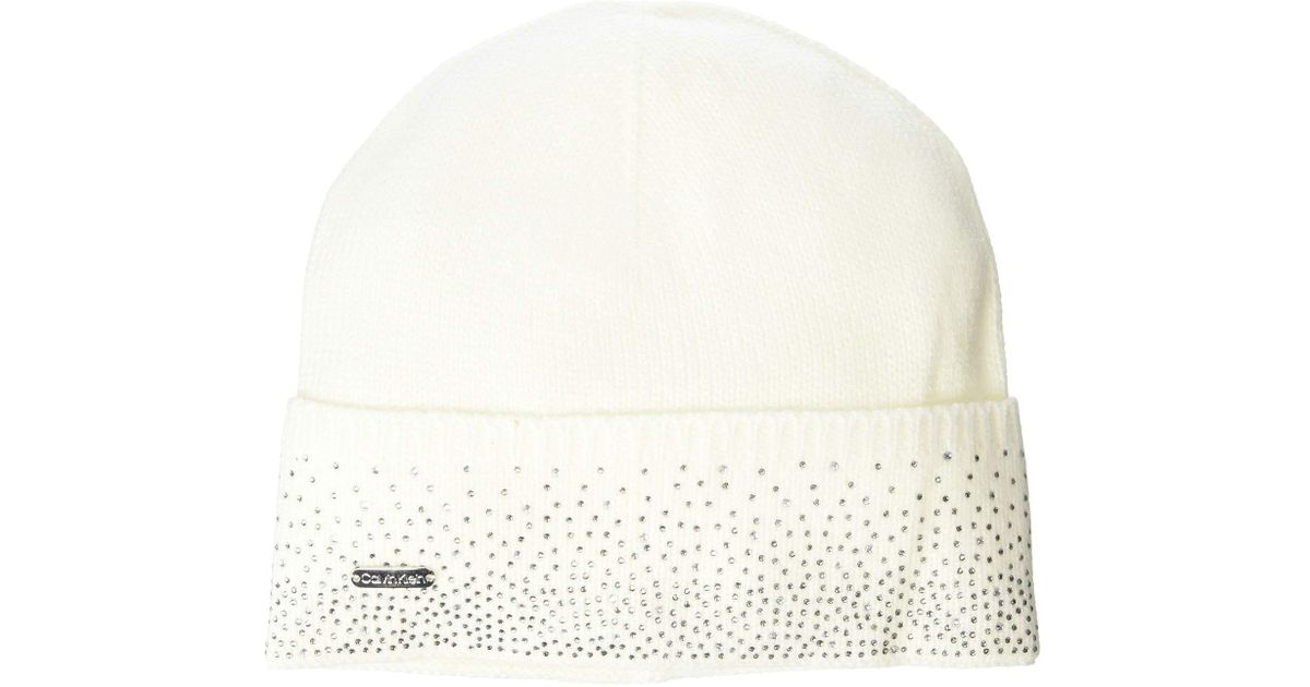 d3053b5bd91 Lyst - Calvin Klein Ombre Crystal Cuffed Beanie in Natural - Save 50%