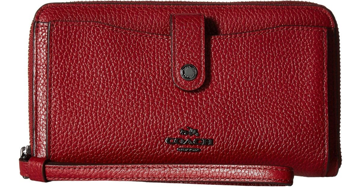 affbd973bff3 Lyst - COACH Polished Pebbled Leather Phone Wallet in Red