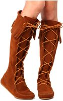 Minnetonka Knee High Fringe Boot in Brown - Lyst