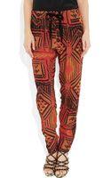 Sandro Paprika Printed Crepe Tapered Pants - Lyst