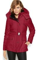 Jessica Simpson Hooded Fauxfurcollar Belted Puffer - Lyst