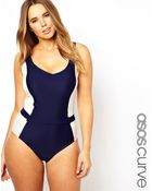Asos Curve Exclusive Belted Swimsuit with Contrast Panel - Lyst