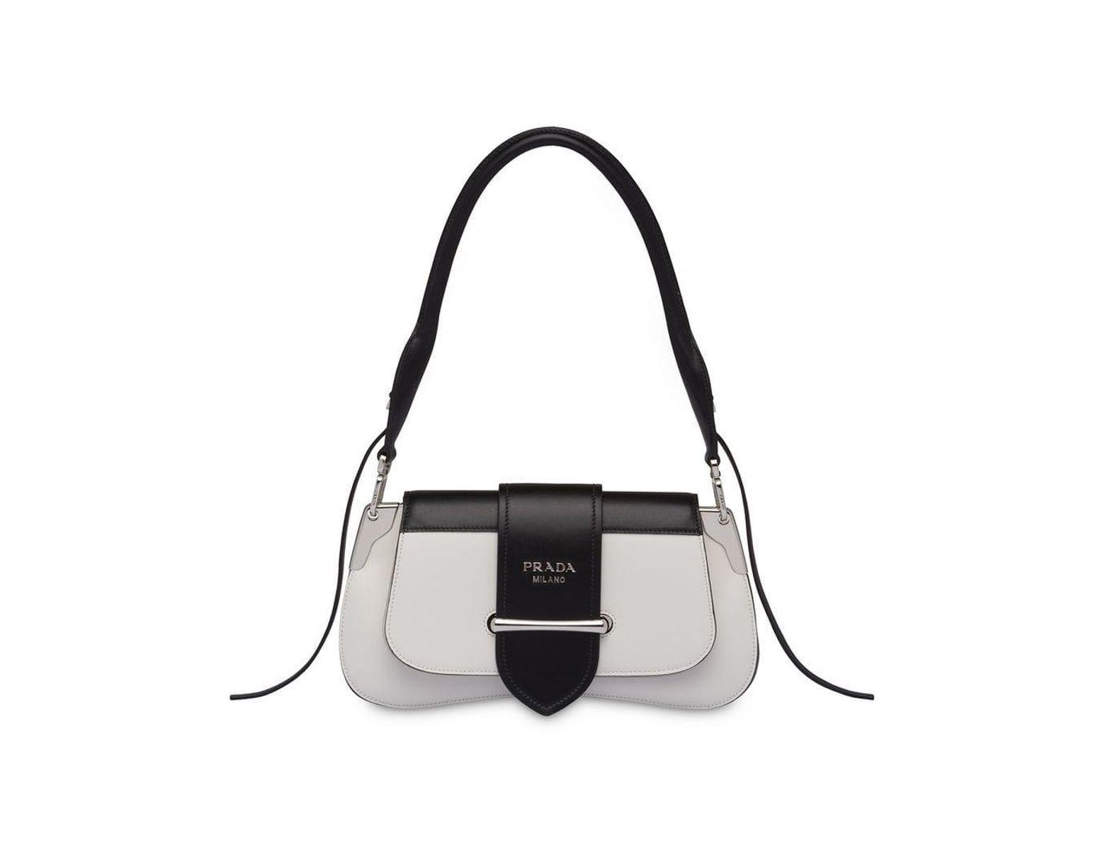 1b05b5568a4 Prada Buckled Sidonie Shoulder Bag in White - Lyst