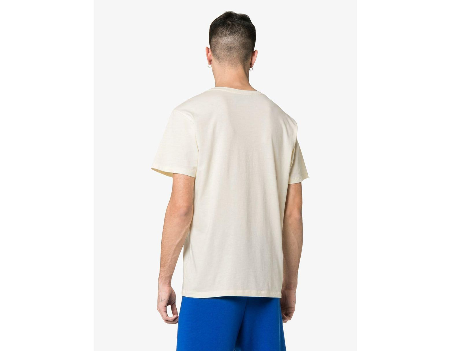 2403c492b5d Lyst - Gucci Winged Jockey Guccy Logo T-shirt in White for Men - Save 29%