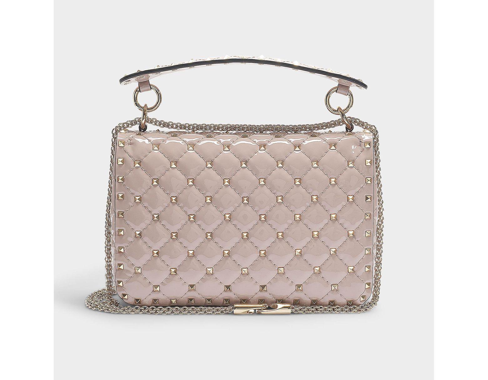 946baca42a1 Valentino Rockstud Spike Medium Shoulder Bag In Poudre Patent Calfskin in  Pink - Lyst