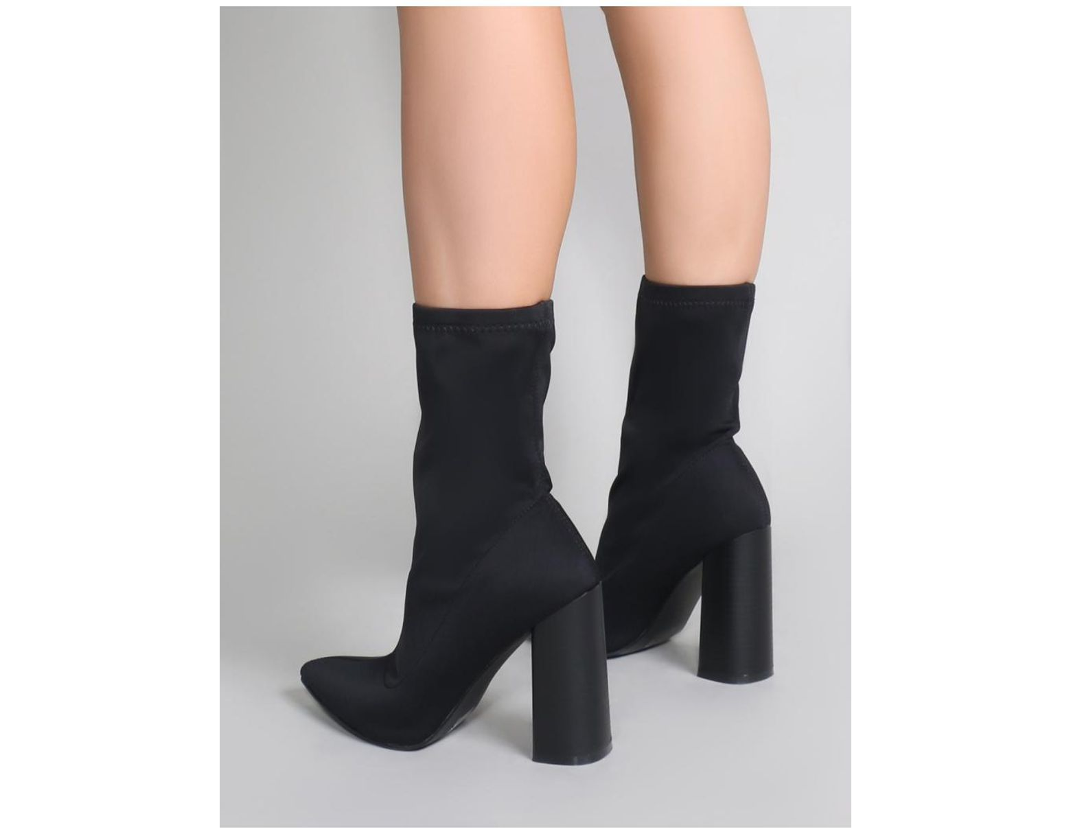 33b80ada573a Lyst - Public Desire Libby Flared Heel Sock Fit Ankle Boots In Black Stretch  in Black