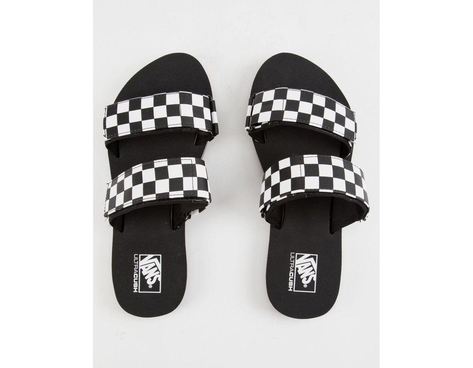 b890aaf33376 Lyst - Vans Cayucas Checkerboard Womens Slides in Black