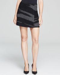 DKNY - Black Tiger Print Mini Skirt - Lyst