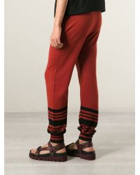 J.W.Anderson - Red Stripe Knit Track Pants for Men - Lyst