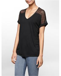 Calvin Klein | Black Jeans Lace Detail V-neck Short Sleeve Top | Lyst