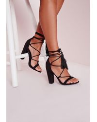 57ca4c89cfa Missguided Lace Up Tassel Block Heeled Sandals Black in Black - Lyst