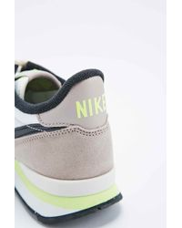 reputable site f2c7f bc962 Nike Internationalist Trainers In Grey And Lime in White - Lyst