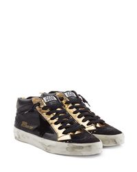 043a82e92537 Golden Goose Deluxe Brand. Women s Black Midstar Leather Mid-Top Sneakers