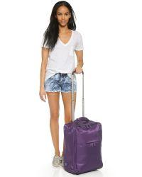 """Lipault - Foldable 2 Wheeled 22"""" Carry-on - Purple - Lyst"""