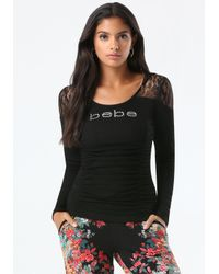 Bebe - Black Logo Lace Hood Ruched Top - Lyst