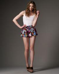 Alice + Olivia - Pink Smocked Floral Shorts - Lyst