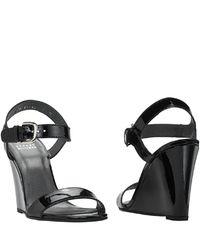 Stuart Weitzman | Strut - Black Patent Leather Wedge Sandal | Lyst